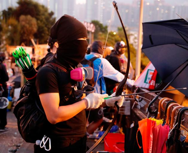 An anti-government protester at a makeshift gate during a standoff with riot police at the...