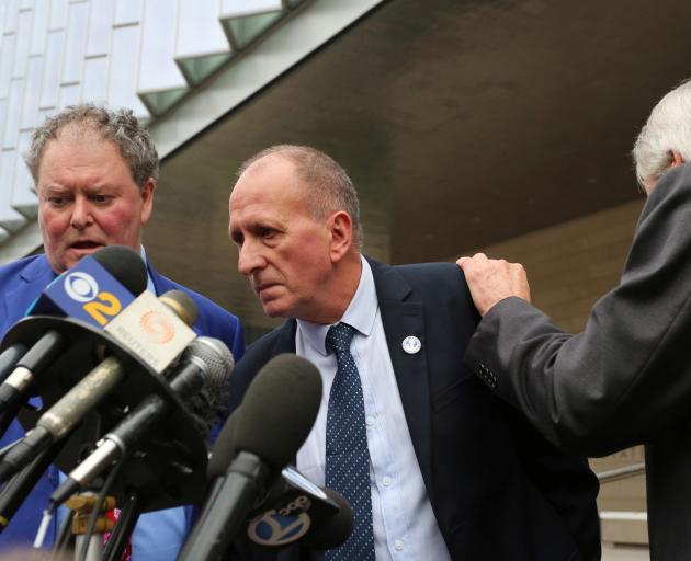 Vernon Unsworth (centre) told reporters he accepts the jury's decision. Photo: Reuters