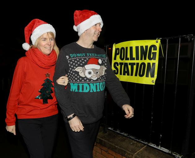 David and Karen Barry arrive at the polling station in West Belfast, Northern Ireland. Photo:...
