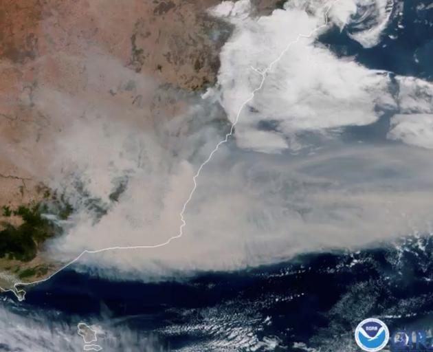 A satellite image shows bushfire smoke being blown away from Australia towards New Zealand on...
