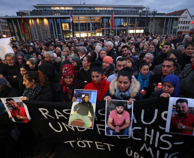 People attend a vigil for the victims of a shooting in Hanau. Photo: Reuters