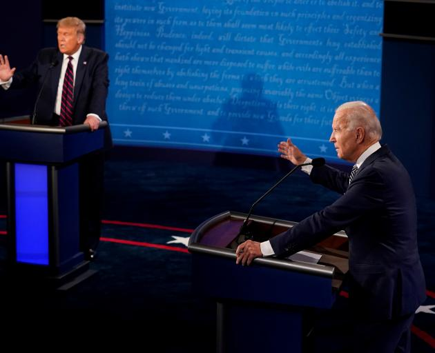 President Donald Trump (left) and Democratic presidential nominee Joe Biden take part in the...