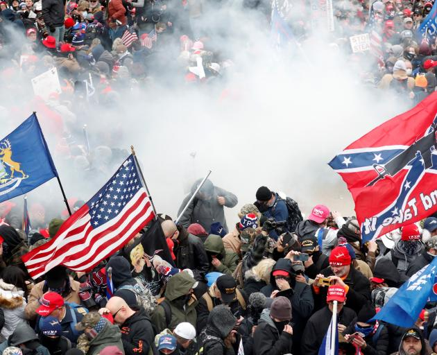 Tear gas is released into a crowd of protesters in Washington DC on Wednesday. Photo: Reuters