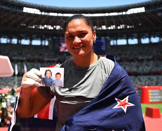 Dame Valerie with a photo of her children, daughter Kimoana and son Kepaleli. Photo: Reuters