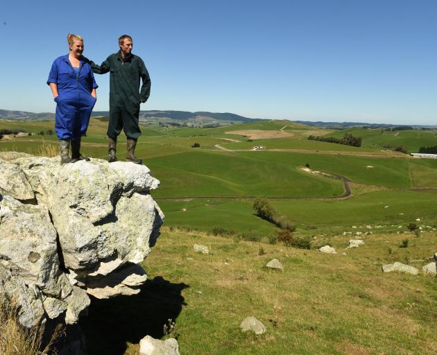 Dairy farmers Ann Linton and Scott Henderson survey the farm they manage near Milton. PHOTO:...