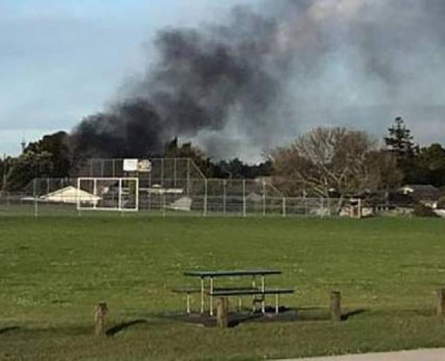 A black plume of smoke could be seen drifting from the property in Don Buck Rd. Photo: Jo Rule...