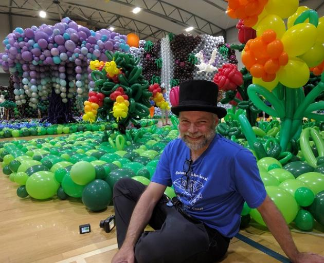 Jim Sheard with the enchanted forest created with balloons.