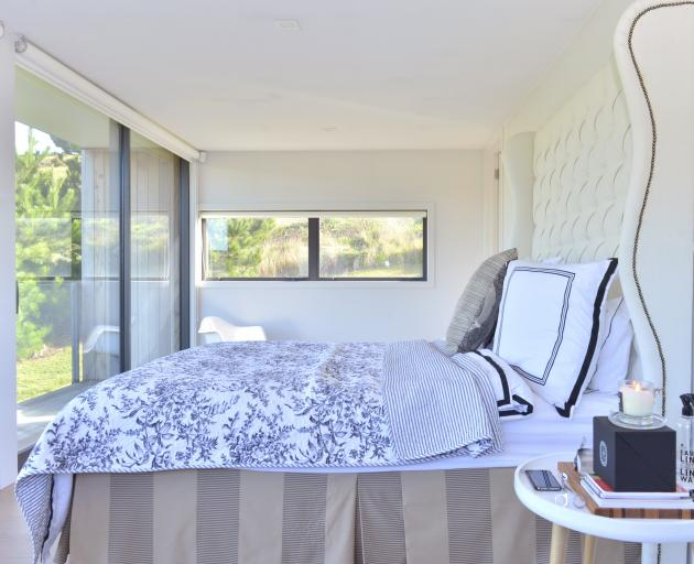 The main bedroom overlooks the St Clair golf course. The 2m-high upholstered bedhead was made by...