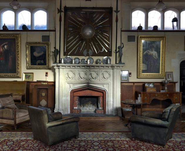 The main hall features a grand Oamaru stone fireplace carved with family coats of arms and has a...