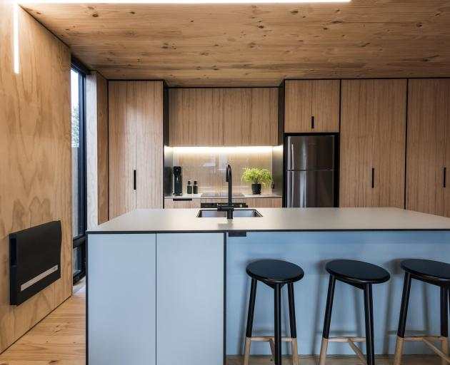 The interior colour scheme is dominated by the honey gold of the cross-laminated pine structure...