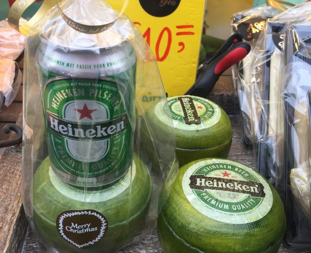 Gouda is coated in green wax and sold with a Heineken at a market in Amsterdam.