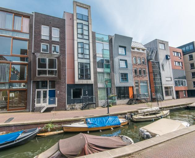 The typically narrow houses of Amsterdam overlook a canal in Java-eiland. Photo: Koen Smilde...