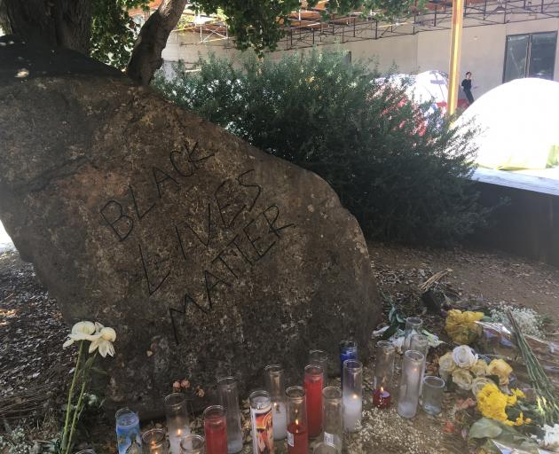 """A """"Black Lives Matter"""" shrine, by artist unknown, is flanked by part of David Hammons'..."""