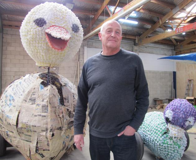Alexandra Blossom Festival organiser Martin McPherson is flanked by an old ''duck and ducklings''...