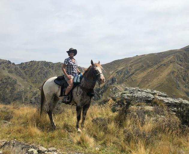 Jacqui Parsons on Reddog in the Waikerikeri Conservation Area. Photo: Supplied
