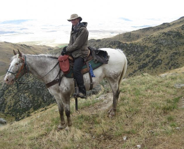 """Richard Parsons on his beloved Cherokee Boi (""""Buddy""""), at the top of Lilico Spur. Photo: Supplied"""