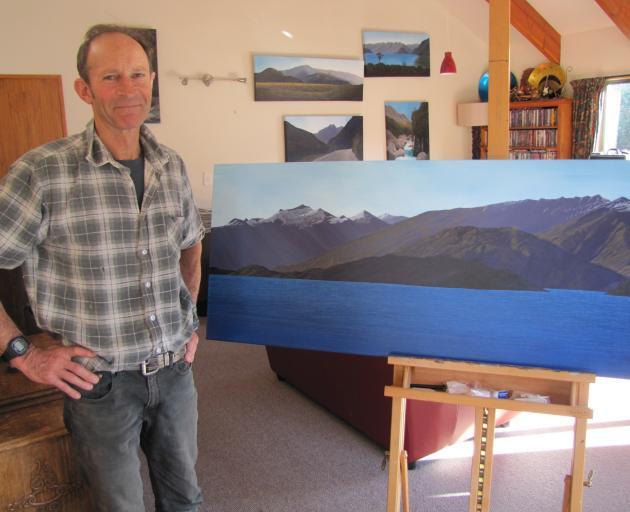 Richard Parsons looks over one of his paintings, of west Lake Wanaka. Photo: Pam Jones