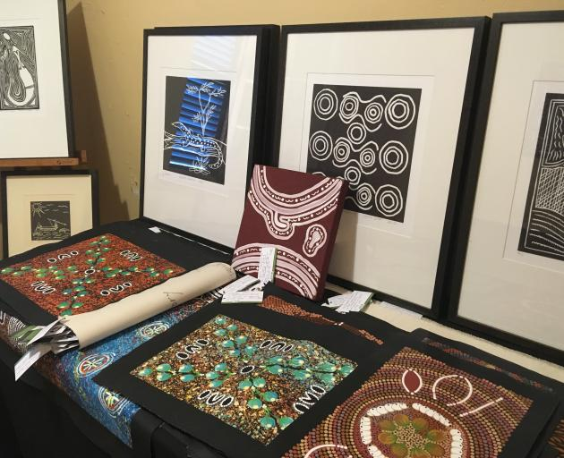 Framed and unframed art is on display at Aboriginal Bush Traders, in the historic Lyons Cottage, on Darwin's esplanade. PHOTO: PAM JONES