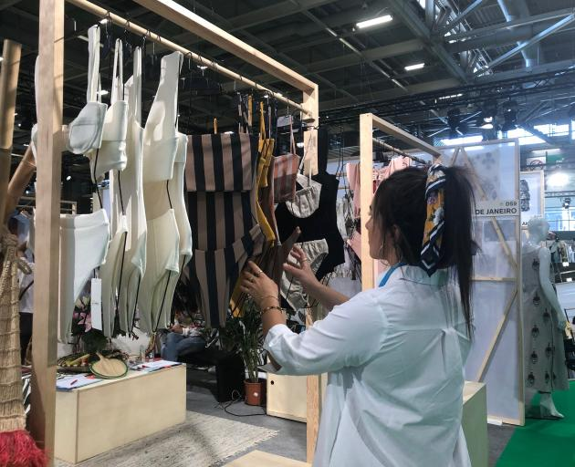 A visitor looks through Sri bikinis by Paris de Janeiro at the expo. PHOTO: SARAH VILELA DA SILVA