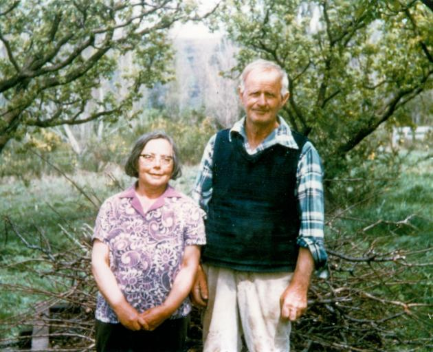 Bert and Alma Jones on their Coal Creek orchard in the 1980s. Photo: Supplied