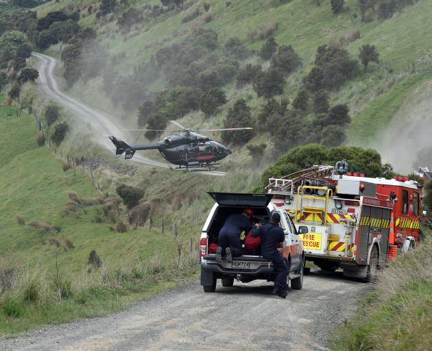 Emergency services at the crash scene in Whareakake Rd. PHOTO: PETER MCINTOSH