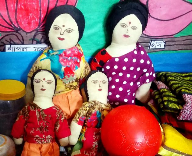 An all-women family of dolls at the education hub's preschool.