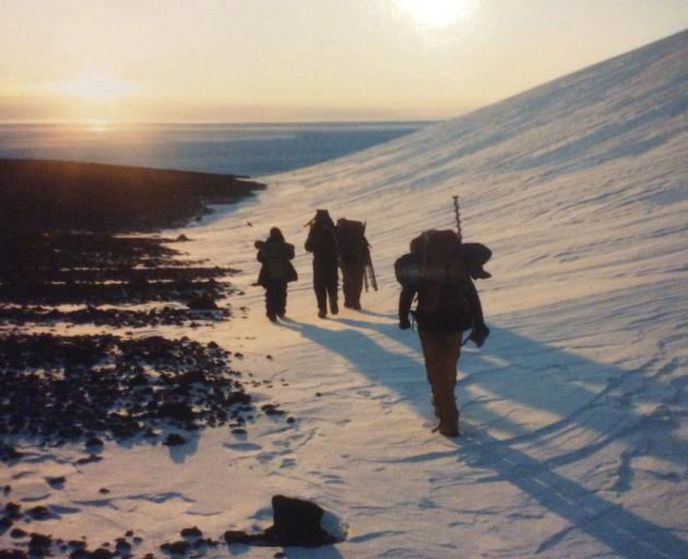 Cameraman Max Quinn and soundman Don Anderson tramp to an emperor penguin colony near Cape Crozier, accompanied by two helpers from Scott Base. PHOTO: SUPPLIED