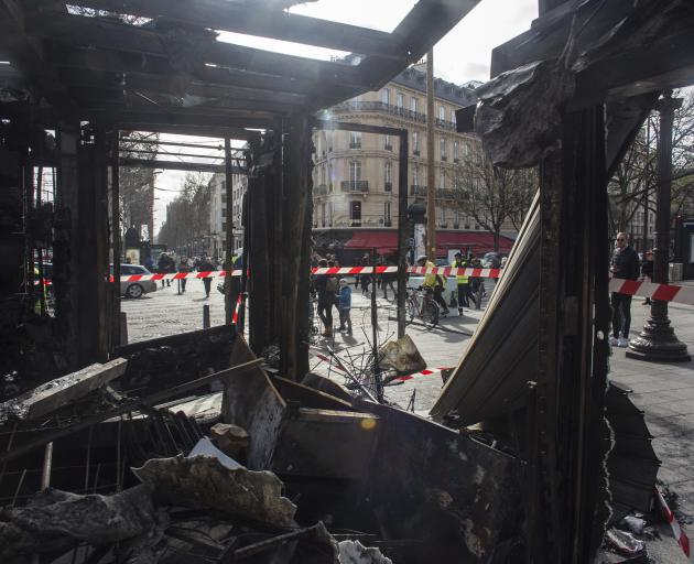 The burned out remains of well known restaurant Le Fouquet on the Champs Elysees. Photo:AP