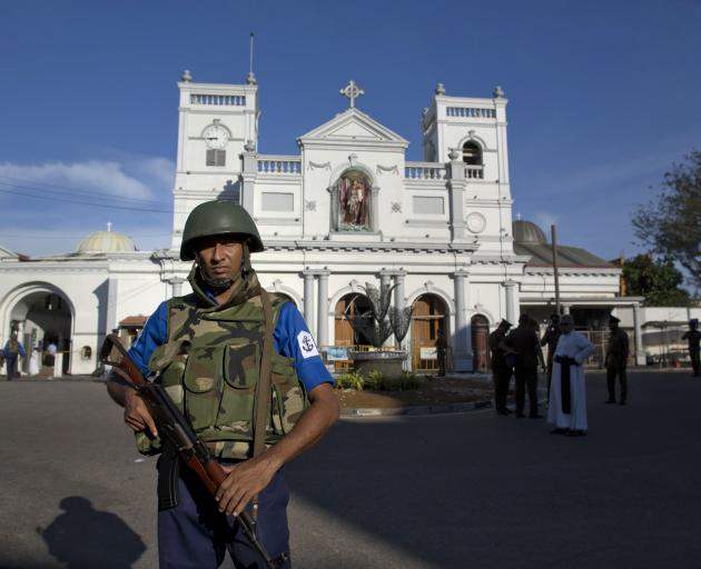 An air force officer guards St Anthony's Shrine, a day after a blast in Colombo. Photo: AP