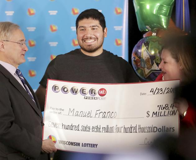 Manuel Franco said he quit work the second day after winning. Photo: AP