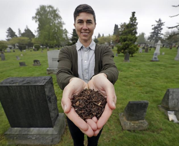 Katrina Spade, the founder of Recompose, with at a Seattle cemetery with a sample of compost...