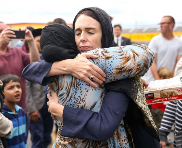 Prime Minister Jacinda Ardern hugs a mosque-goer at the Kilbirnie Mosque in Wellington, two days...