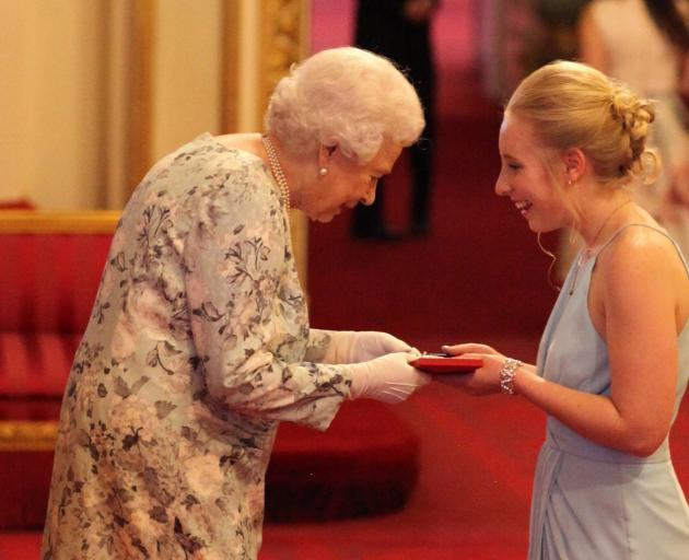 Ashleigh Smith receives her Young Leaders Award from the Queen at Buckingham Palace. Photo: Getty...
