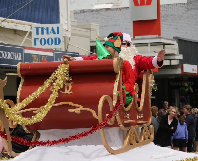 To the delight of many, Santa arrives at the parade in Balclutha on Saturday.
