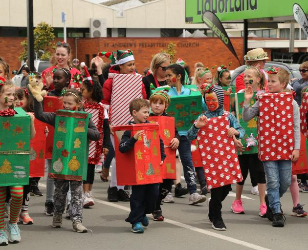 Children from Balclutha Primary school march as boxes and Christmas packages at the Clutha...