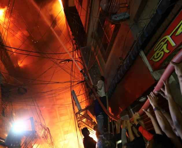 The blaze broke out at a warehouse storing chemicals in Dhaka. Photo: Reuters