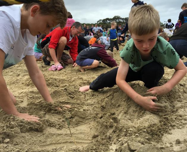 Ieuan Horlock (13, left) of Sydney, and Jackson Phillips (8) of Dunedin take part in the...