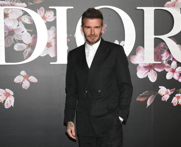 Former England football player David Beckham at a Dior men's fashion show in Tokyo. Photo: Getty...