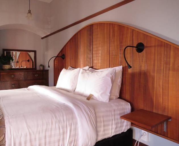 The impressive headboard in the Oak bedroom.