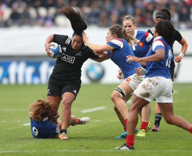 Black Fern Linda Itunu tries to evade Pauline Bourdon of France at Stade des Alpes. Photo: Getty...