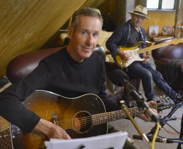 Netherworld Dancing Toys frontman Malcolm Black rehearses for his new solo album in the home...