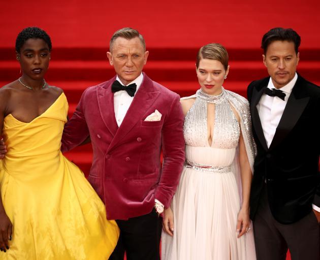 Cast members Lashana Lynch, Daniel Craig, Lea Seydoux and director Cary Fukunaga at the premiere....