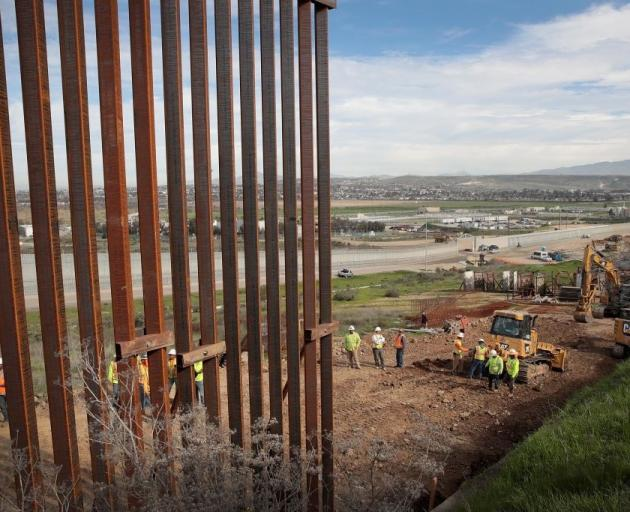 About 1120km of fencing has been erected along the US border with Mexico. Photo: Getty Images