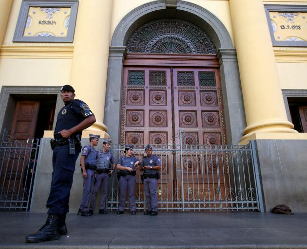 Police guard the cathedral in Campinas following the attack. Photo: Reuters