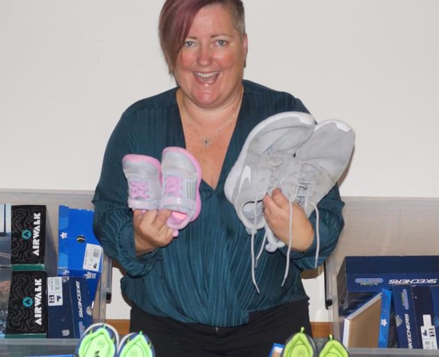 Bronnie McKenna with some of the shoes donated so far. Photo: Supplied