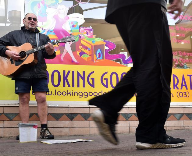 Dunedin busker Jackson Caine may not be able to play in his usual spot in Albion Lane if a...