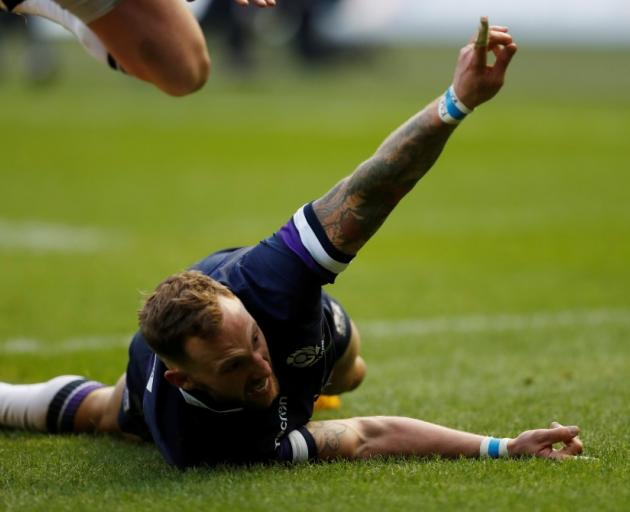 Scotland's Byron McGuigan celebrates scoring one of two tries in the match against Australia....