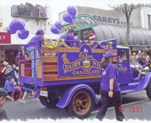 A Cadbury van joins a  parade.
