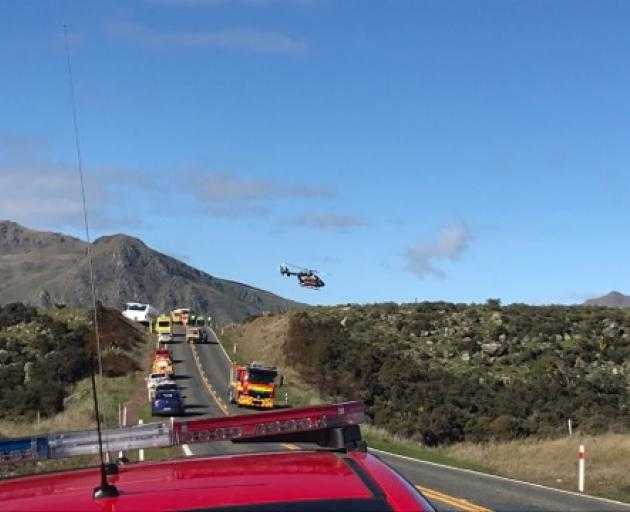 A helicopter leaves the crash scene. Photo: Daisy Hudson