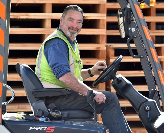 Kevin Small drives a forklift at Cargill Enterprises.